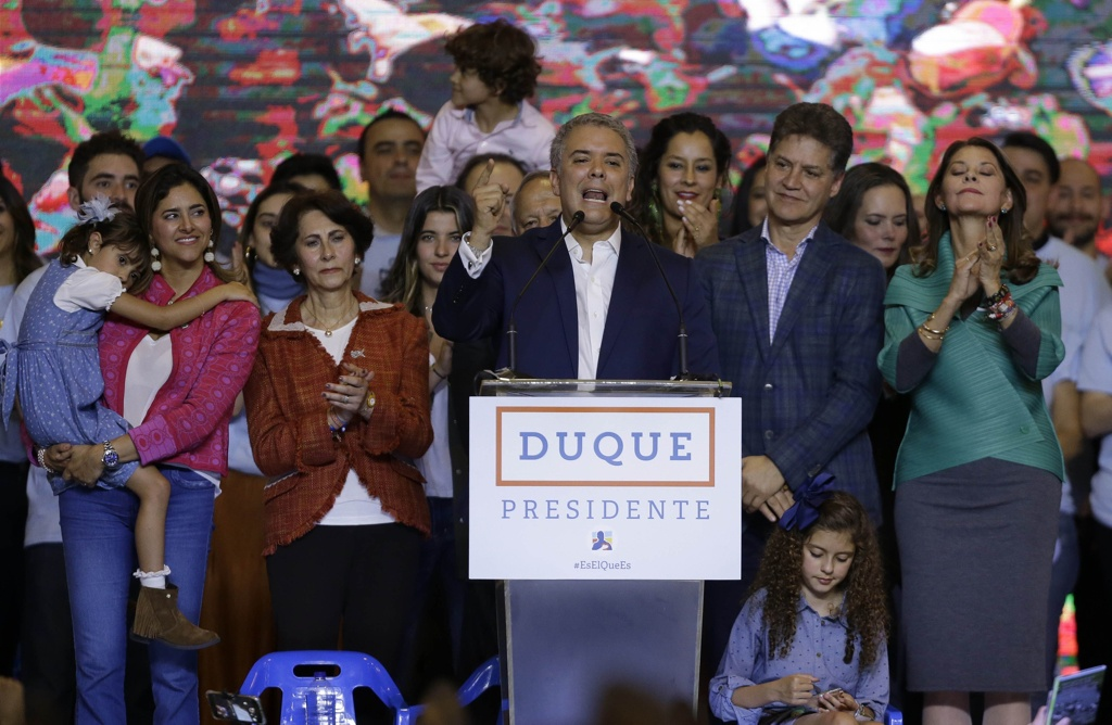 Colombia's President Elect Ivan Duque speaks to supporters after his victory in the presidential runoff election in Bogota, Colombia, last night