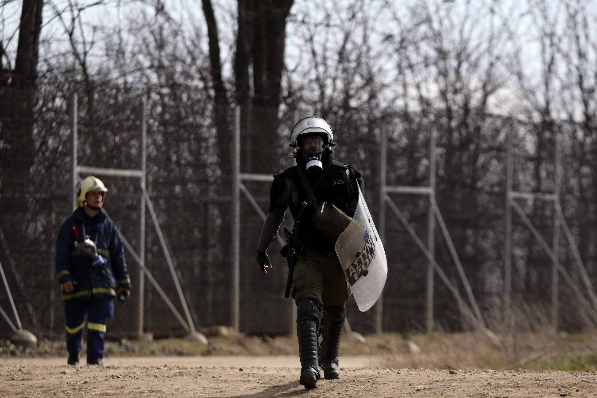 A Greek riot policeman walks near the Kastanies border gate at the Greek-Turkish border