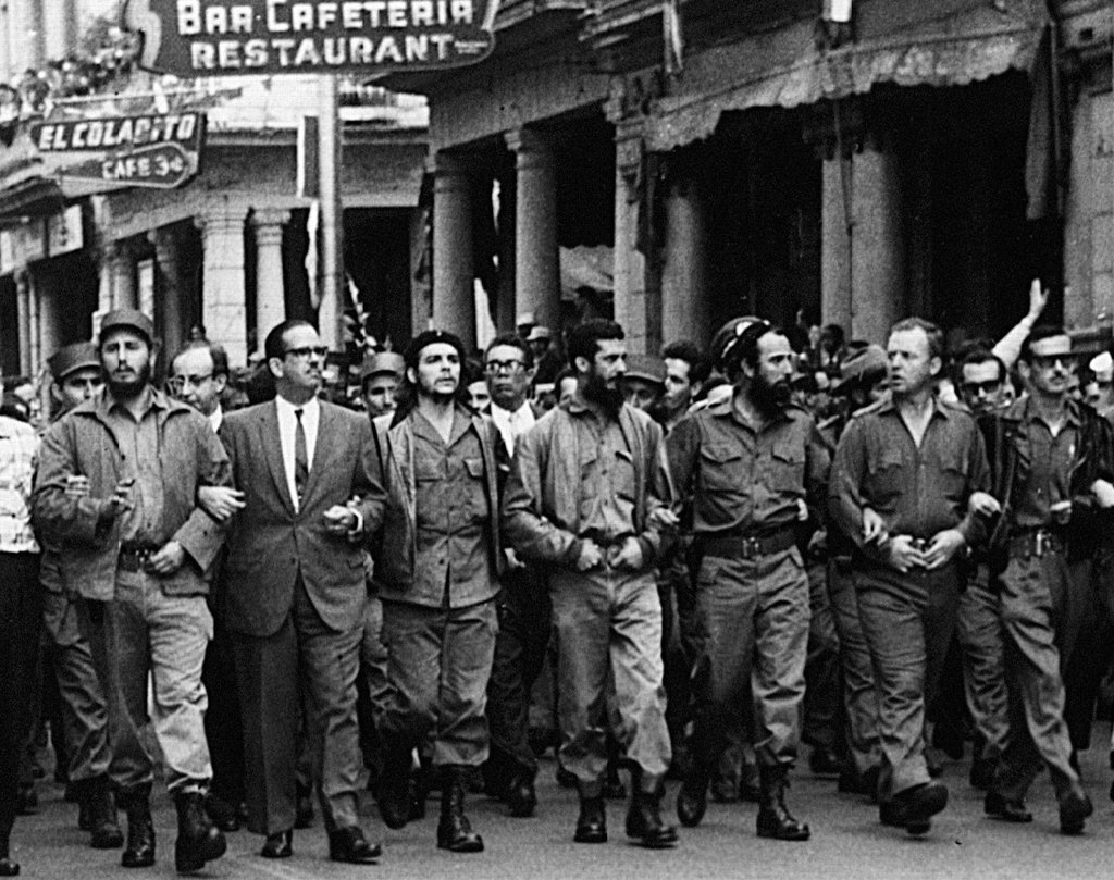 Fidel Castro (far left), Che Guevara (centre), and other leading revolutionaries marching through the streets in protest over the La Coubre explosion, 5 March 1960