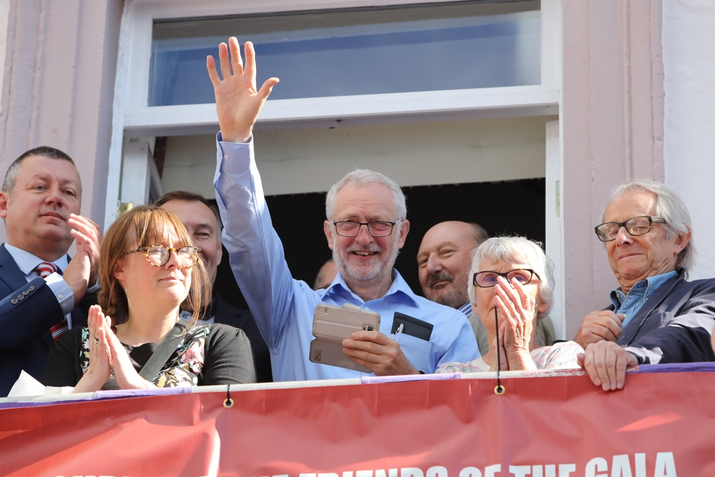 Labour leader Jeremy Corbyn (centre) and film director Ken Loach (right) watch the parade during the Durham Miners' Gala this July