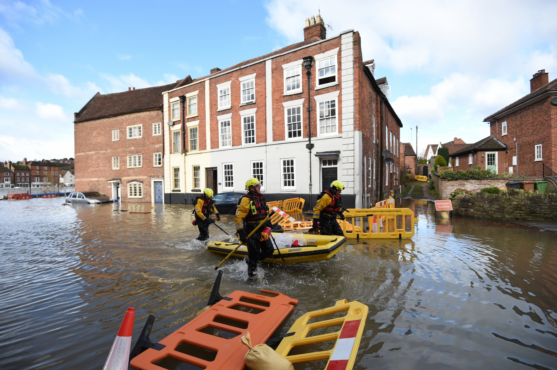 Fire and Rescue officers use an inflatable raft in Bewdley, Worcestershire, as the River Severn remains high, with warnings of further flooding across Britain