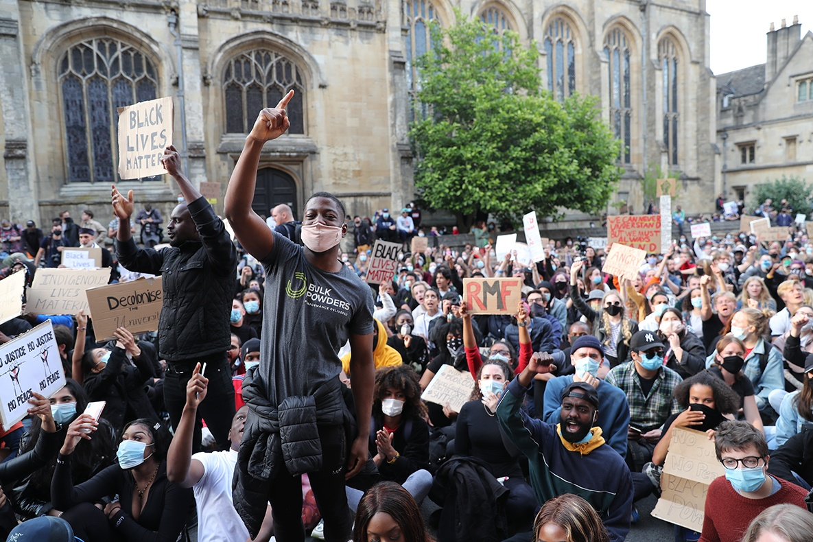 People during a protest calling for the removal of the statue of 19th century imperialist, politician Cecil Rhodes from an Oxford college in June