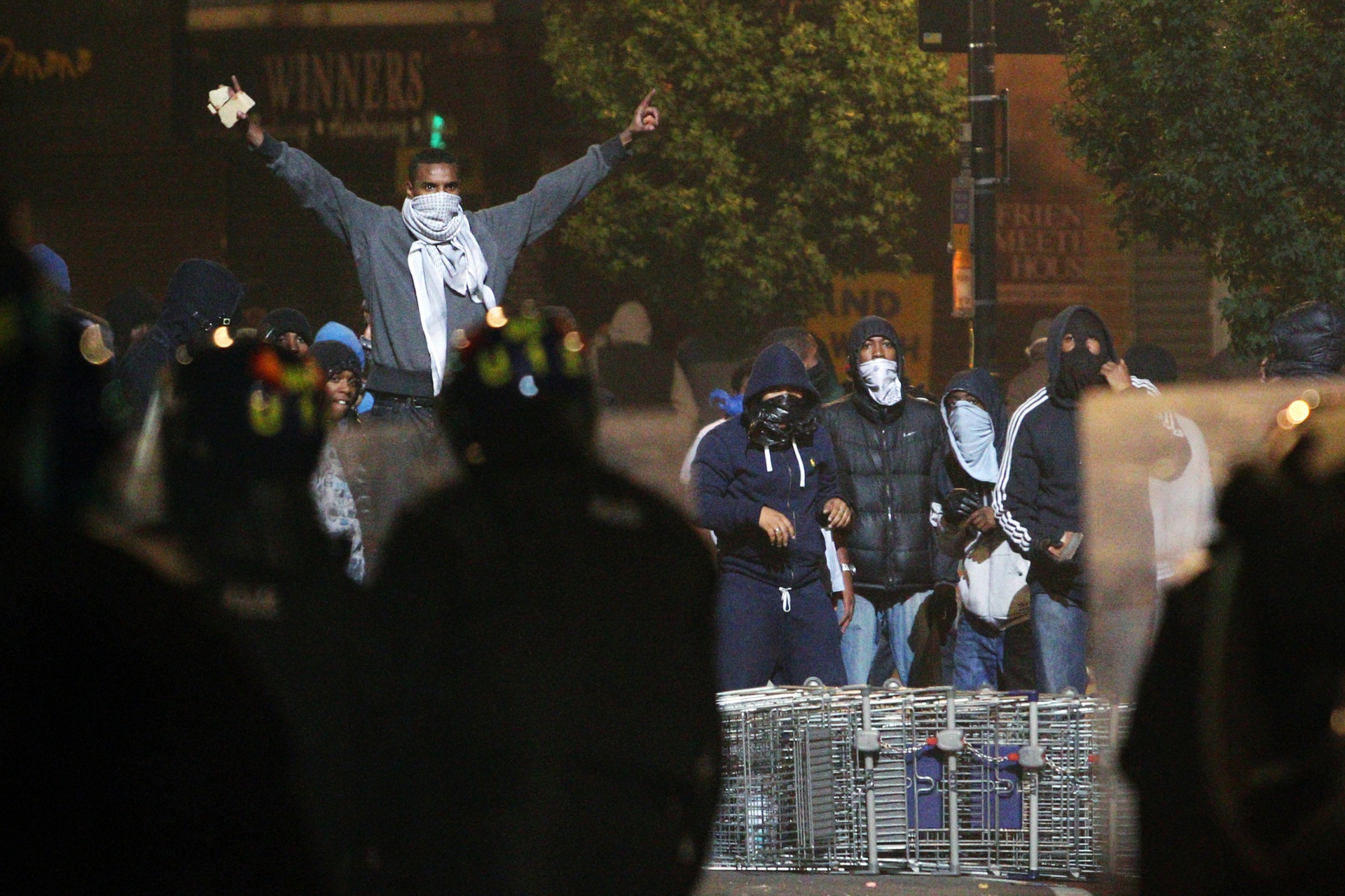 Trouble flares in Tottenham, north London, as members of the community take to the streets to demand justice after Mark Duggan, 29, was shot dead by police, August 2011