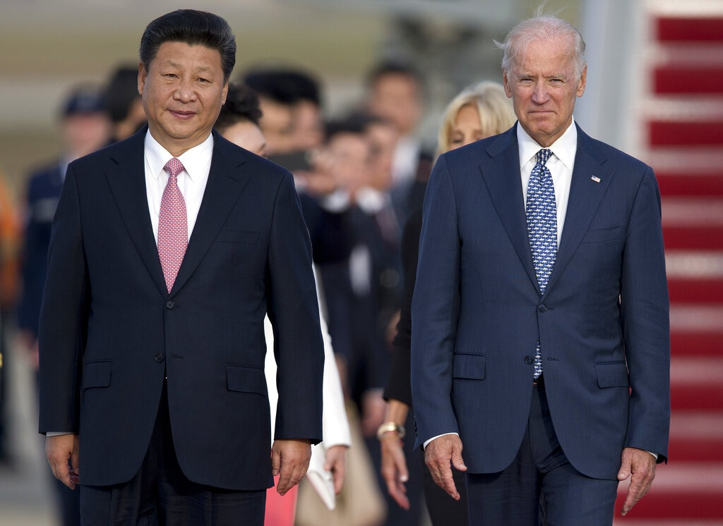 Chinese President Xi Jinping and then US vice-president Joe Biden, pictured in a file photo from 2015