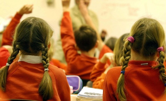 Children sit in a classroom