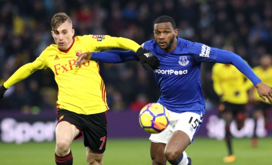 Watford's Gerard Deulofeu (left) and Everton's Cuco Martina battle for the ball during the Premier League match at Vicarage Road, London.