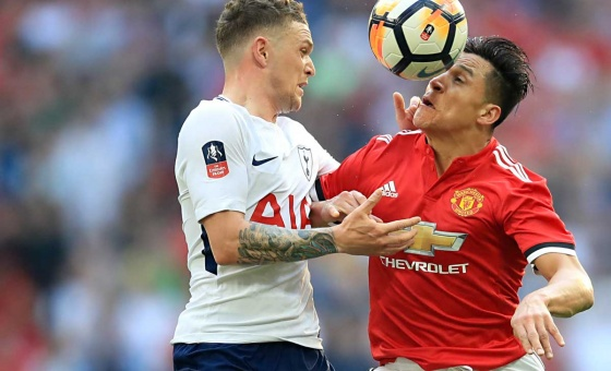 Tottenham Hotspur's Kieran Trippier (left) and Manchester United's Alexis Sanchez battle for the ball during the Emirates FA Cup semi-final match at Wembley Stadium, London.